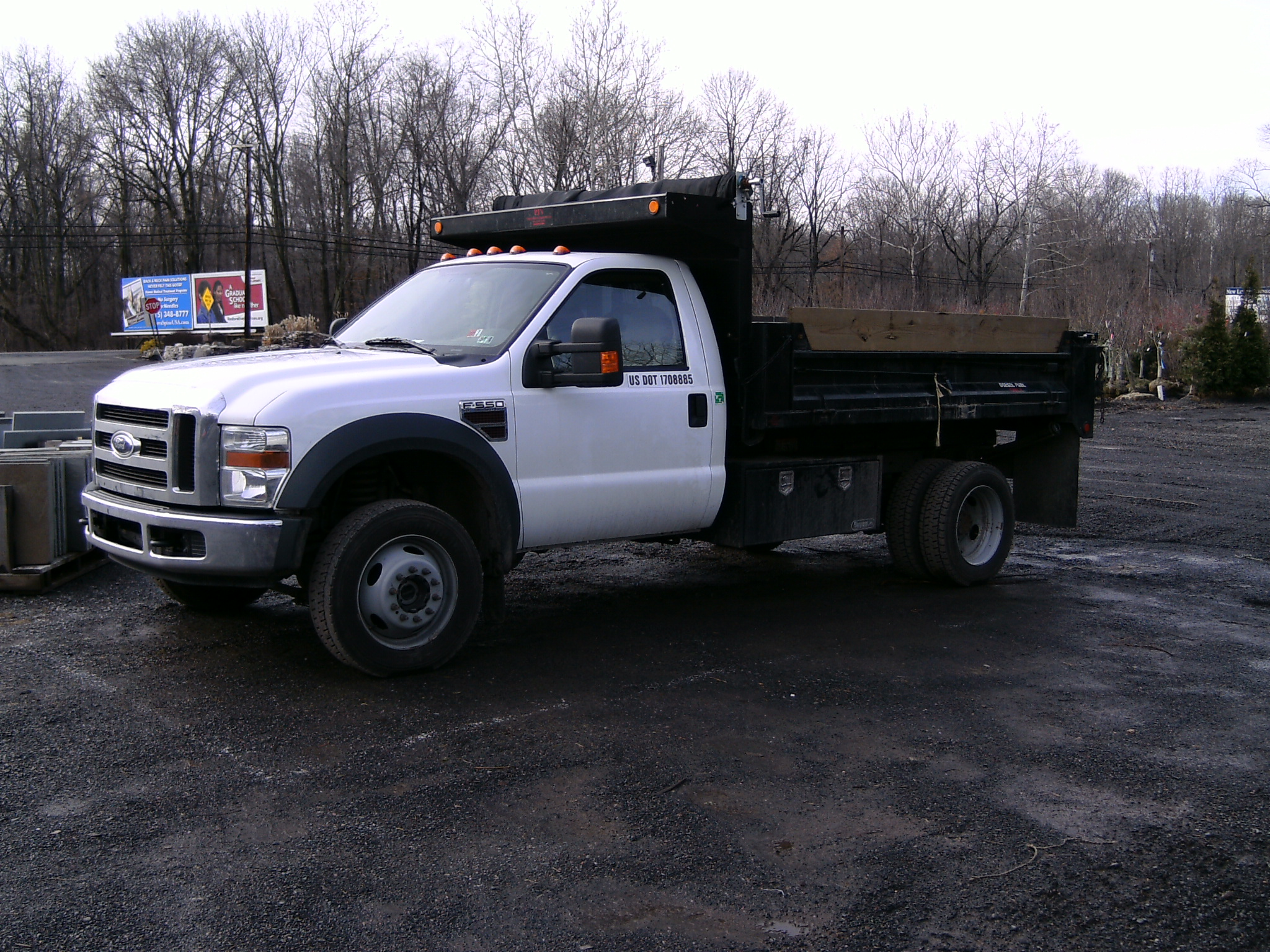 Our F550 Dumptruck  with Crew Cab. Fold Down Sides and with 4WD.